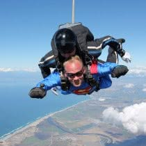 Men-Giving-SMile-while-Doing-Skydiving