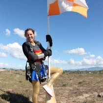 Women-Showing-Flag-after-success-of-Skydiving
